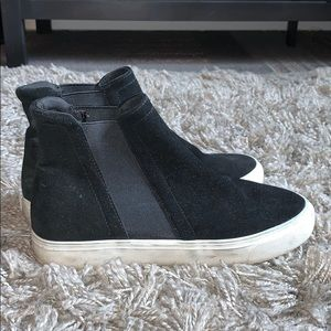High top black and white slip ons